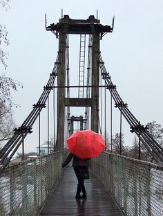 red umbrella on a bridge. Photo by umbrella on a bridge. Photo by Umbrella Art, Under My Umbrella, Color Splash, Color Pop, Walking In The Rain, Singing In The Rain, Arte Black, Splash Photography, Black White Red