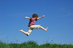Great Photo of child leaping freely, head leading.