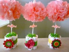 cute and adorable DIY baby girl shower centerpiece idea - make your own using tissue paper pom pom