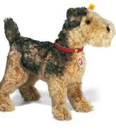 This Steiff Classic 1935 style Airdale Terrier is a made from mohair and has a genuine leather collar. Surface washable.  Dimension: 30cm  Back in stock early December 2012