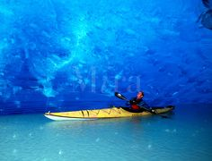 Sea kayaker Ehren in ancient ice cave, Russell Fjord Wilderness, near Yakutat, Tongass National Forest, Alaska. (MR