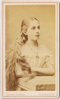 Though her face conveys little emotion, one cannot help but be enamored with this strikingly beautiful young Victorian woman and her flowing locks. #Victorian #19th_century #1800s #photograph #antique #vintage #woman #hair #long_hair