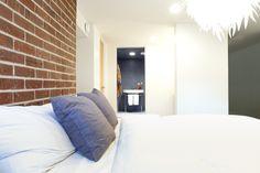 Trout Lake Residence - #bedroom #lighting #openplan #brickwall #featurewall
