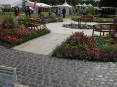 Awarded gold at Holker Show, the 'Water Wheel' #garden was created by Register members Sharp Paving. The interesting ciruclar shape was created using a variety of Marshalls products including Fairstone Sawn large flags in autumn bronze, Fairstone planks and 'Drivesys- The Original Cobble' in Basalt.