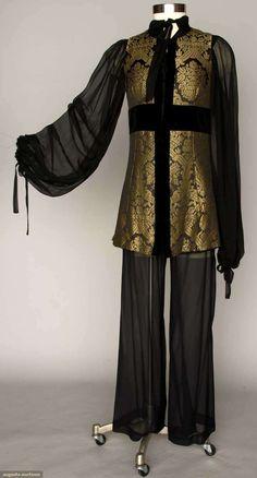 "THEA PORTER EVENING ENSEMBLE, 1970s  3-piece: unlined black chiffon pants & balloon sleeve blouse, sleeveless long jacket in black & gold Renaissance patterned brocade, B 33"", W 26"", Pant Inseam 29.5"", Jacket L 30"", ""Thea Porter London"" labels"