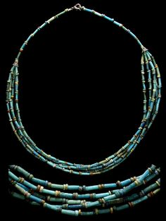 by Ancient Resource (Gabriel Vandervort)   Necklace; Ancient Egypt, Late Period, 664-535 BC. blue-green faience tube beads interspersed with fine yellow, green, red, blue and black disk beads. Restrung on modern jewelry wire and silver beads and clasp   375$