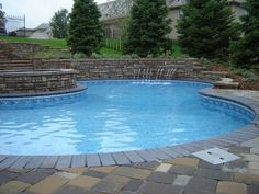 #Vinyl #pool with raised acrylic spa, stone retaining walls, stone coping and stone paver deck system. This gorgeous pool & Spa was designed and built by Bonsall Pool and Spa.