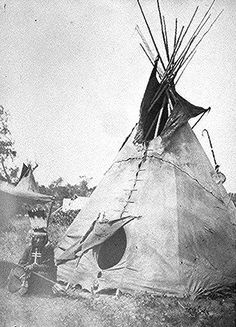 Little Big Mouth, a medicine man, seated in front of his lodge near Fort Sill, Oklahoma, with medicine bag visible from behind the tent. Photographed by William S. Soule, 1869-70.