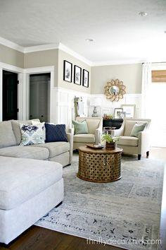 Greige, tan beige in living room with wainscoting board n batten