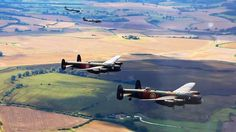 Tagged: Allied | A British Treat: 2 Lancasters Escorted By 2 Spitfireshttp://worldwarwings.com/a-british-treat-2-lancasters-escorted-by-2-spitfires