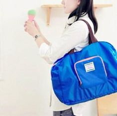 Casual Stylish Woman With Blue Multifunctional Foldable Waterproof Duffel Bag - Side View Bags Online Shopping, Online Bags, Travel Bags Carry On, Travel Tote, Shopping Travel, Shopper Bag, Backpack Bags, Duffel Bags, Messenger Bags