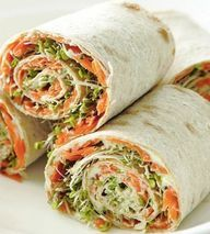 Healthy Snack Recipe: Tortilla, humus, shredded carrots, avocado, beans, thinly sliced tomato and sprouts.