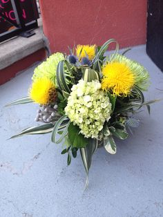 Bright yellow and green posy with a touch of blue