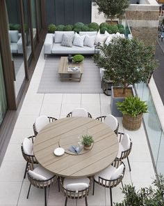 The penthouse terrace we have dressed with contemporary furniture and outdoor fabrics and all faux planting. Faux buxus balls by… Rooftop Terrace Design, Terrace Floor, Small Terrace, Terrace Garden, Outdoor Rooms, Outdoor Living, Outdoor Furniture Sets, Outdoor Decor, Moderne Lofts