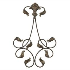 Highlight a favorite plate, then decoratively display it on the wall with an acanthus leaf scroll plate rack. Graceful scrolls secure and display plate. Additional scrolls draw attention.