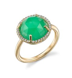 A stunning rose-cut emerald green stone adds a modern twist to a classic halo setting from Irene Neuwirth  $3,280