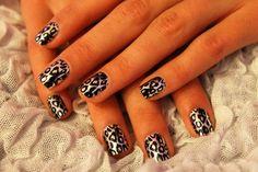 Metallic leopard nails.