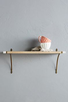 Marble-Edged Floating Shelf in blonde wood, brass attachments. #anthropologie