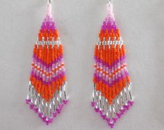 These Beautiful Native American Beaded Kaleidoscope Earrings are custom made by Elaine out of Delica Beads. They are 5 inch long and 2 inch wide with Magnesite Beads on them. With silver plated ear wires on them, Can be changed to post or clips.If you have any Questions just ask. Thanks for looking.