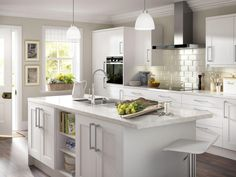 Brimming with flair and grace, with white carried throughout the look, from cabinets to worktops and walls, this kitchen gives a bright look guaranteed to open your space.