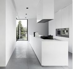 Not really a fan of all white, but this is awesome. Good use of space for long, narrow kitchen space.
