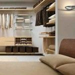 Walk-in-wardrobe-with-rack-system-in-maple-finish-with-bedroom-9