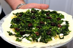Broccoli raab pizza with roasted onions and olives - Not-so-Ordinary Pizza Recipes curated by SavingStar. Get free grocery coupons at savingstar.com