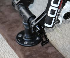 Over the last few years, a big change was made in Mountain Bike fork designs with the 15mm through-hole axle. While this gives a lot more stability for downhill racing and for larger (heavier) riders, it has also proven to be a bit more of a hassle to transport your bike from place to place. There are conversion kits you can buy from Thule and Yakima, but they are upwards of $40 and clip on to an existing rack system. If you want to mount to a truck bed or SUV floor, then ...