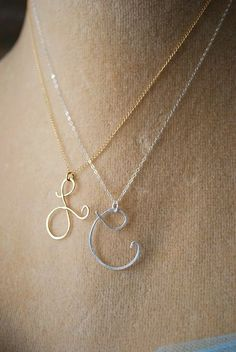 "I LOVE this initial necklace!! There are a number of the initials that are super pretty like the ""L"" & ""A"". Also made in Rose Gold. Say my Name Initial by makepienotwar on Etsy - $39"