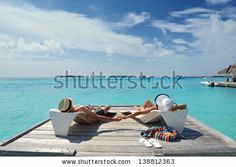 happy young romantic couple in love have fun running and relaxing on beautiful beach by dotshock, via Shutterstock