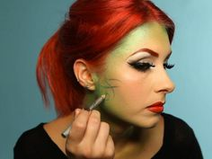 With shimmering green eyeliner pencil, add swirly vines stemming from the hairline, reaching toward the center of the face without going too far into your cheeks