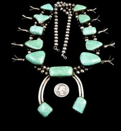 Circa 1940s: This is a REMARKABLE Old Pawn vintage Navajo sterling silver Squash Blossom necklace featuring absolutely AMAZING giant cabochons of Carico Lake turquoise! Re: Old Pawn (or Dead Pawn) Technically, Old Pawn just means an item which has been pawned and let go (not paid for) by the owner. The Trading Post or Pawn Shop then resells the item to get their money back. People commonly associate old/dead pawn with vintage or antique Native American Indian jewelry. This is not always the…