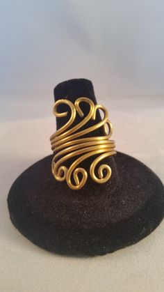 This 16 gauge dead soft gold toned jewelers wire is formed into waves of golden curls. A size 8 ring. Another unique addition that could be yours.