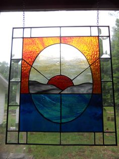 stained glass sunset over lake with bevel border