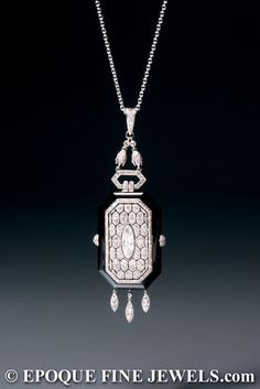 Boucheron ,A very rare Art Deco onyx and diamond pendant watch.