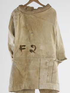 Straitjacket - Mayday Hills Hospital, Beechworth, Victoria, Australia, circa 1900  Heavy cream canvas straitjacket worn by female patients as a restraining device at a mental health hospital.