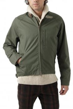 Brooks England jacket in hunter green color - jacket designed for cyclists made of cotton, zipper collar, closed buckle, hanging raglan sleeves, made in waterproof and windproof cotton, longer and rounded on the bottom back, shoulder straps sewn inside, storage pockets on backside, three front pockets. Brooks England Fall Winter 2012 2013 Collection. Brooks England, Cyclists, Hunter Green, Shoulder Straps, Green Colors, Rain Jacket, Windbreaker, Fall Winter, Zipper
