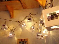 Hiding fairy lights in cubes made out of old slides - sounds like a great idea that I have to try.