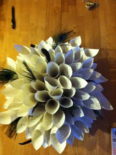 Book wreath with peacock feathers