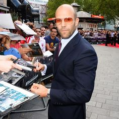 Jason Statham Film's Action Man incarnate upgrades his otherwise straightforward blue suit/white shirt combination with a collar bar and superbly Seventies-vibing tinted aviators at the London premiere of The Expendables 3. Sometimes it's all in the details.