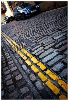 Road paint on cobbled lane