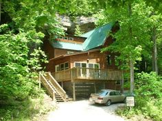 ... Multilevel Cabin Built In Front Of A Limestone Cliff That Towers Above  It, Located In A Secluded Forest Valley Adjacent To Natural Bridge State  Park ...