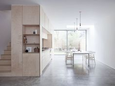 This fabulous conversion by architect Larissa Johnston uses a custom built plywood unit that house the kitchen and stairs as well as clever storage.