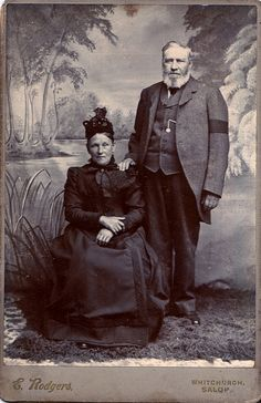 British Couple in Mourning, Albumen Cabinet Card, Circa 1880. She is dressed in full mourning. He wears a black arm band.