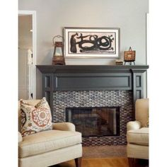 Fireplace is Sherwin Williams Black Fox satin sheen oil based paint. Gorgeous!  Would be beautiful door or cabinet color. Wall color is SW Morris Gray 0037