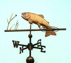 Leaping Trout Weather Vane by West Coast Weather Vanes.  This custom made handcrafted Leaping Trout weather vane consists of a copper fish and splash rings with brass grasses and a gold leafed bug.