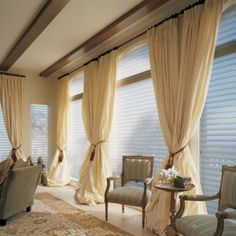 Not in this color but I absolutely love long drapes ceiling high. It makes your walls appear higher than they are and it's a classic look.