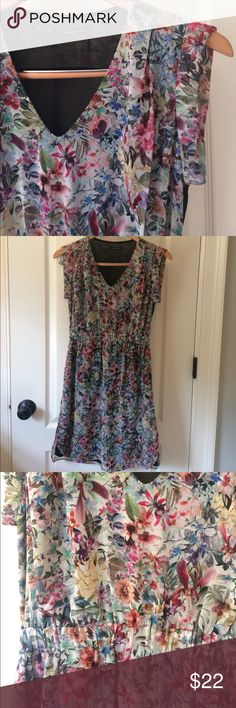 Zara Basic floral dress with sheer back. Adorable! Zara Basic floral dress with sheer back. Adorable! Black sheer panel on the back. Elastic Flattering waist. Sheer floral dress with sheer black lining. Zara Dresses
