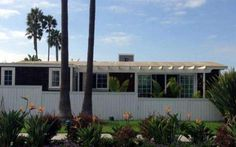 Newport Beach dream mobile home! Pergola deck top, custom roof trim, window molding, beautiful bathroom tile, and much more! This remodel is packed full of inspiration for your next project. Double Wide Remodel, Double Wide Home, Double Wide Manufactured Homes, Manufactured Home Remodel, Remodeling Mobile Homes, Home Remodeling, Bathroom Remodeling, Newport Beach, Modern Cottage Style