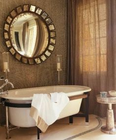 Suzanne Kasler bathroom with classic sunburt mirror.  French enough for me.